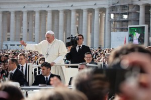 VATICAN - October 30: Pope Francis I on the popemobile blesses the faithful crowd in St. Peter's Square in Vatican on October 30, 2013.